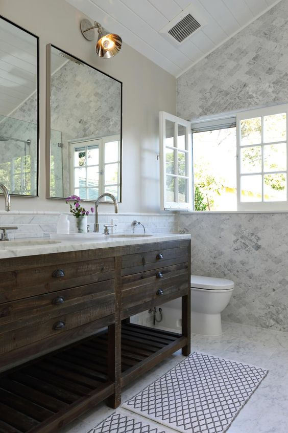 The rustic wood vanity is a striking contrast to the - Carrara marble floor tile bathroom ...