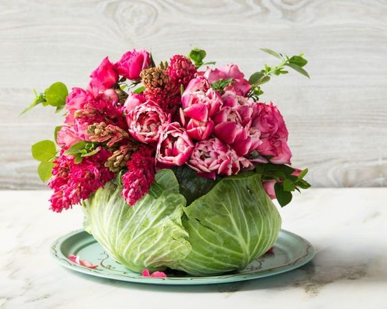 Cabbage Flower Centerpiece — the instructions from Southern Living for this are very easy to follow. You just have to hollow out a hole in a head of cabbage large enough to accommodate a Mason jar. Wouldn't it look extraordinary on your mom's dining room table? #mothersday #centerpiece #flowerarrangrment: