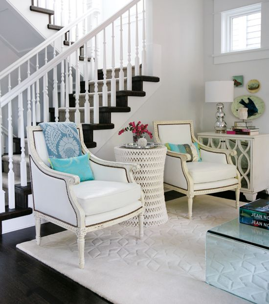 dark hardwood floors contrast so well with these white chairs!