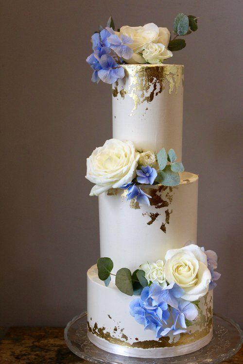 Modern Three Tier Smooth Buttercream With Edible Gold Leaf Www Cakesbyyolk Com Wedding Cake Gold Leaf Classic Wedding Cake Wedding Cakes With Flowers