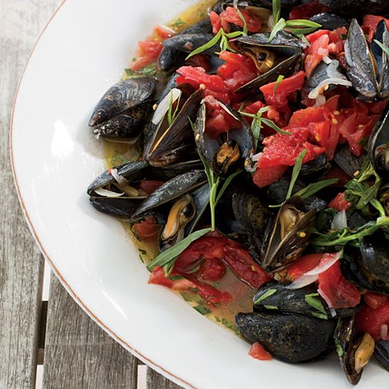 One of the first recipes that star chef Tom Colicchio learned to cook was a version of these steamed mussels, packed with tomatoes and fresh tarragon.