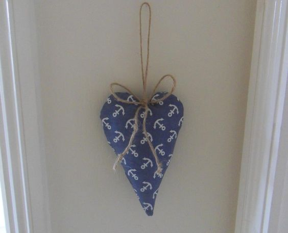 Hanging heart for my living room. I used garden string for the bow.
