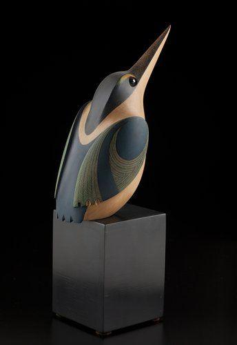 Medium: kauri, hematite, wood base. Size: 9.75 x 3 x 4 inches (incl. base).: