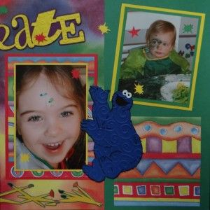 Girl doing crafts and finger painting scrapbook page with Cookie Monster from Cricut's Sesame Street Friends