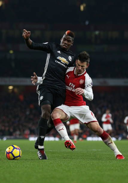 Paul Pogba Of Manchester United And Laurent Koscielny Of Arsenal