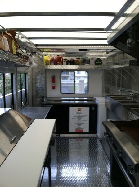 I love the clean crisp feel of the inside of this food for Food truck interior design