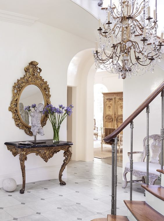 Timeless French Decorating Ideas {Tara Shaw}. New Orleans based designer, Tara Shaw, has the classicism of Old World coursing through her veins. She is known and celebrated for her sophisticated designs featuring collections of highly curated antiques, rich glamorous textiles, tone on tone color palette paired with contemporary elements. Neoclassical and Louis XV elements pop against the brilliant whites of her home foyer, welcoming her and her guests to her beautiful home.