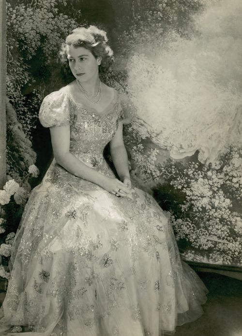 ravenclawwit: Princess Elizabeth (Queen Elizabeth) in a dress designed by Norman Hartnell. (Click for full size)