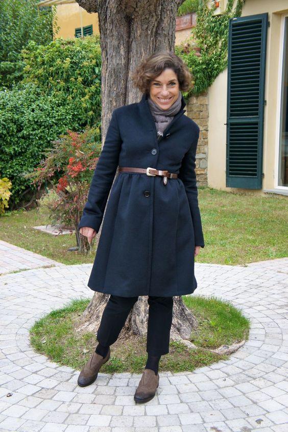 O casaco é Miu Miu e as calças Banana Republic.