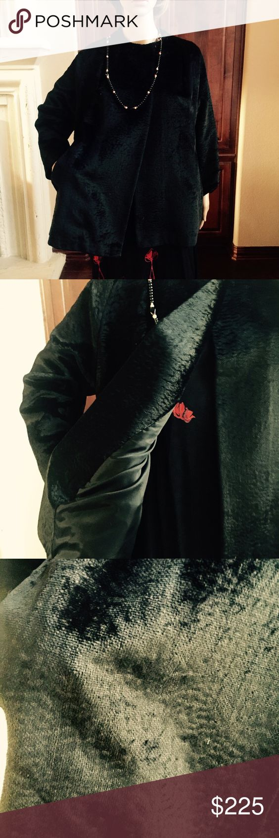 Antique very heavy coat. Feels like silk velvet Very heavy.  Neck has two snaps. Has new lining (shown) at one point which covers name.  Not sure if fur or heavy velvet evening jacket with side pockets. Was in bidding lot with Art Deco cigarette case (sold). Jackets & Coats