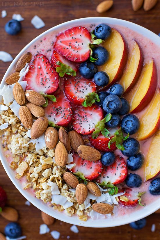 This berry, peach and coconut smoothie bowl is packed full of fruit, fiber and protein! It's a simple and easy way to turn a healthy smoothie into a filling meal! #ad