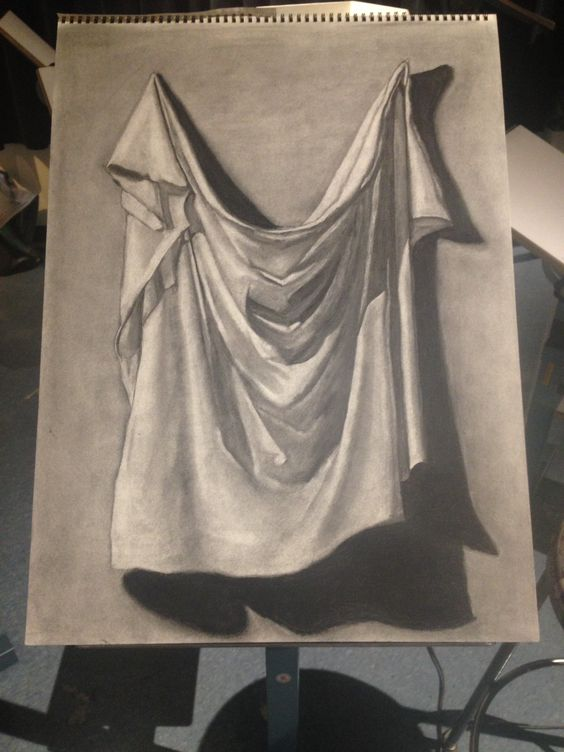 A charcoal drawing of a draped cloth. This drawing was assigned in my Freshman Drawing I class. It was later hung in the mid-year show.
