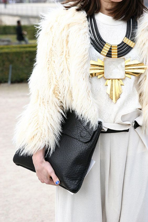 { all white with a statement necklace }: