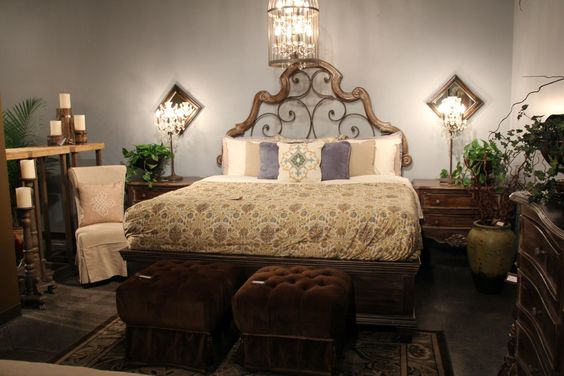 Great bedroom design...love the wrought iron and wooden headboard