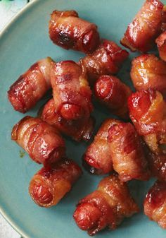 Bacon-Wrapped Hot Dog Bites – Guaranteed to be a crowd-pleaser at your next cocktail party, these bacon-wrapped hot dogs are baked with sugar, spice and everything nice. Delicious appetizer recipe coming right up!