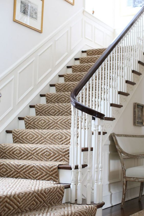 Staircase with sisal stair runnner, panel moulding and white walls. Staircase sisal stair runnner. #Staircase #sisal #stairrunnner J.K. Kling Design.