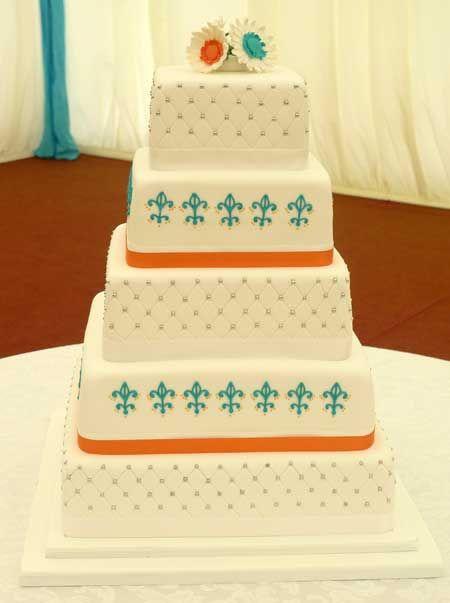 Turquoise & Orange decorated wedding cake by Genuine Cakes