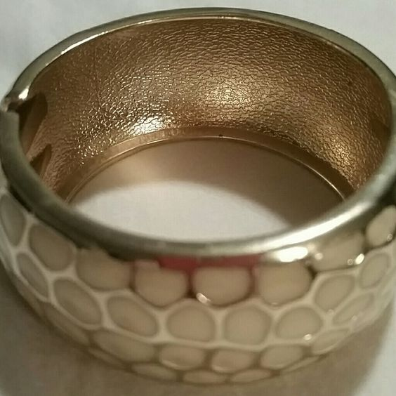 Beautiful enamel hinge bracelet from the Limited Gold and cream enamel print bracelet,  hinge design.   Goes with any outfit to add that extra pop!  Gently loved. The Limited Jewelry Bracelets
