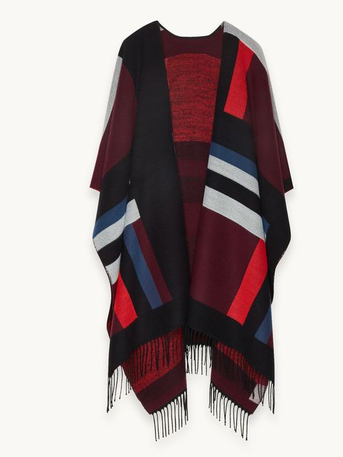 Poncho multicolor con motivo geométrico ETINCELLE. El poncho, elaborado en un género de mezcla de lana, exhibe un magnífico motivo geométrico integral. Fíjese también en el detalle de flecos a los lados. ¡Una apuesta garantizada de estilo y confort en cualquier época del año!