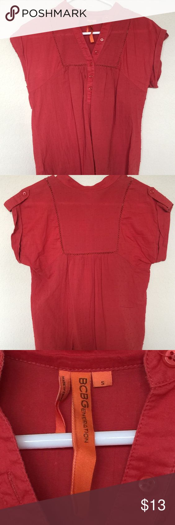 BCBGeneration Top BCBGeneration top in a reddish/coral color. Short sleeve with bottoms down the front. Fun top for spring and summer! Used but in good condition. Purchased at BCBG store in Kansas City. Message if you have any questions! BCBGeneration Tops Tees - Short Sleeve