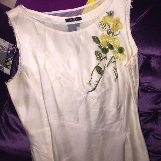 BCBG cream dress with sheer overlay. BCBG cream dress with sheer overlay. Flowers on left breast. BCBG Dresses Midi
