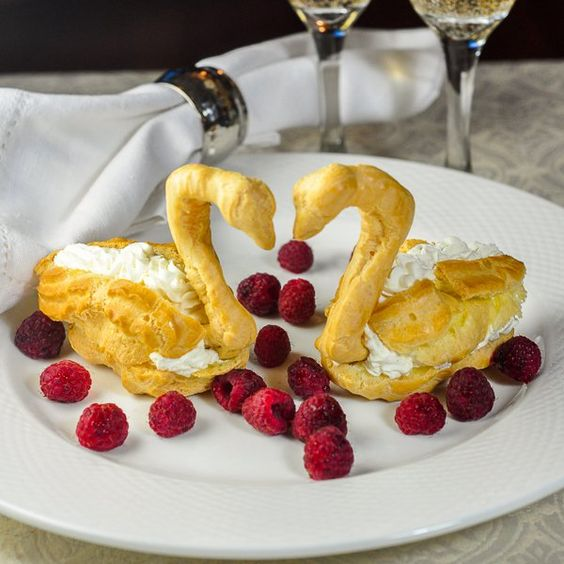 Profiterole Swans with Chantilly Cream and Raspberries - an old fashioned presentation of profiteroles from decades ago. For Valentines Day & bridal showers
