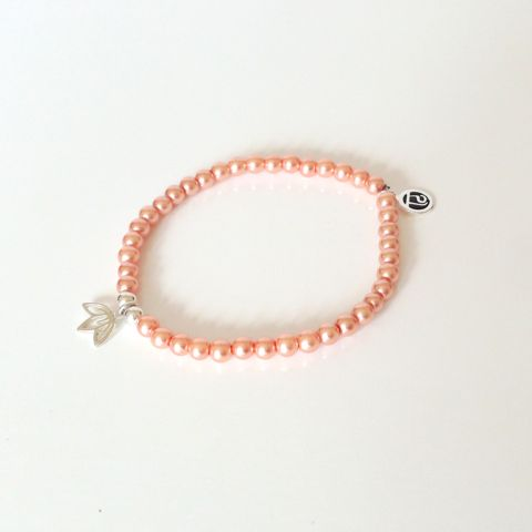 Goddess Intention Bracelet - Compassion Edition Always act with the upmost love and be pure to your authenticity. People around you know that your true nature represents being a goddess and giving love to everyone you meet.Peach pearls symbolize romance, compassion, kindness and loyalty. The lotus flower is your reminder to stay in line with your true values and always act with full intention.