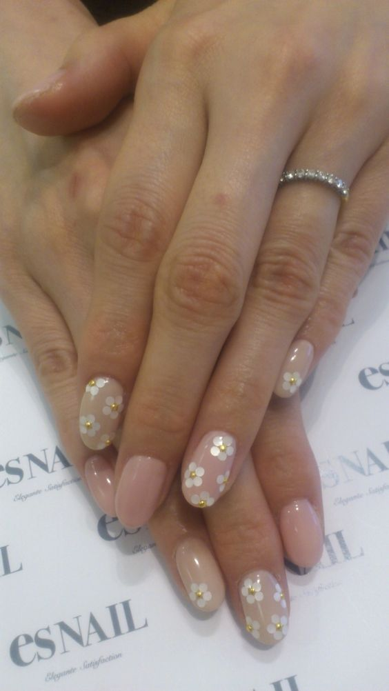 Would get with french tips slightly more squared and flowers underneath the tips