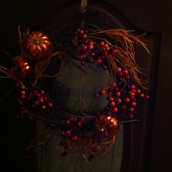 Easy DIY you can use over and over. Grapevine wreath from HOBBY LOBBY with whatever individual seasonal wreath pieces you wish! Don't glue or fasten so that you can easily change from season to season. Entire project cost less than $20 (make sure you hit the 40-50% off sale)!