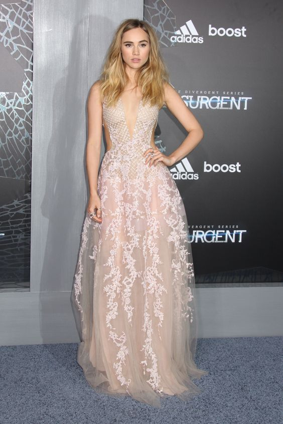 No longer merely Bradley Cooper's plus one, Suki Waterhouse took to the red carpet in her own right for the premiere of her first mega-flick 'Insurgent':