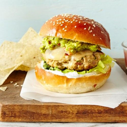 Don't let winter get between you and a burger! This Chili Chicken Burger is the bomb, with gauc and crema you'll be addicted to.