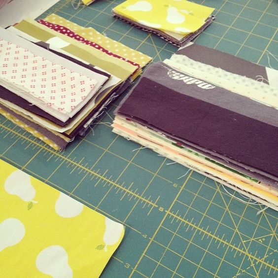 sorting through fabric leftovers.