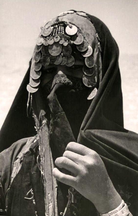 "Jordan | Bedouin woman, wearing a ""caffa"" and an ""iorja"".  Madara, Amman Province.  ca. 1956 | ©Joseph Chelhod:"