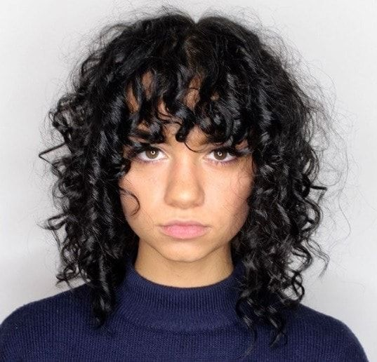 Woman With Shaggy Curly Bob Length Hair With Curly Bangs Curly