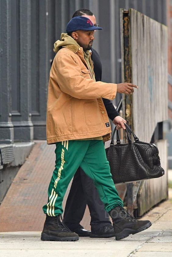 Kanye West wearing Yeezy Season 3 Boots, Bottega Veneta Ebano Intrecciato VN Large Duffel, Adidas Yeezy Season 4 Calabasas Sweatpants, Brain Dead Mohair Snapback Cap Hat: