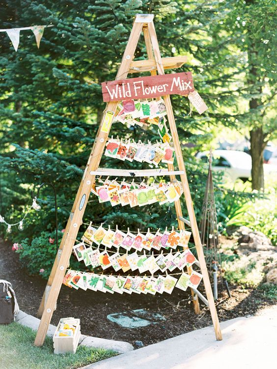 rustic wedding decor ideas to display wedding favors on vintage ladders