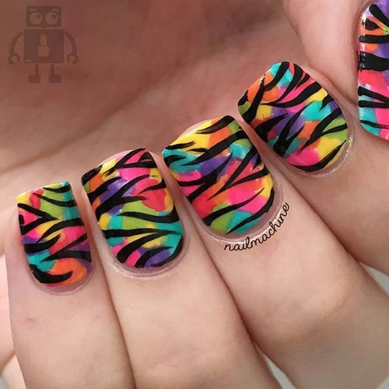 Another variation of the zebra-type print on top of a rainbow-base nail. The base is more like patches of colors of the rainbow and the stripes are smaller.