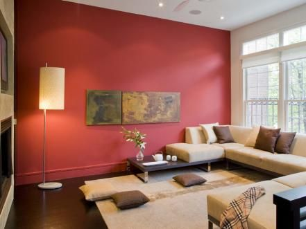 While beige is a neutral, shades of your favorite colors can also act as neutrals in your room. A neutral just needs to be a balance of warm and cool tones, like the shade of red used in this living room.