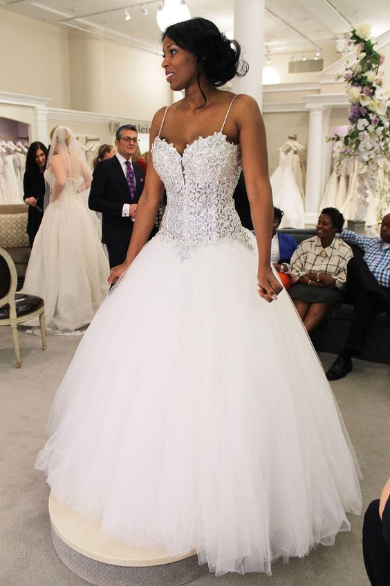 Season 14 Featured Dress: Pnina Tornai. All bling top. Sweet heart neckline with white poofy skirt and corseted back. $10,900.