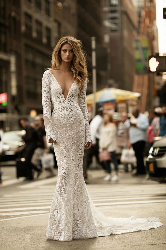 Sexy wedding gown with plunging neckline and sleeves // BERTA's Fall/Winter 2017 bridal collection is sending us to #weddinggown heaven with its showstopping silhouettes matched beautifully with 3D flowers, lace appliques and rich embellishments.