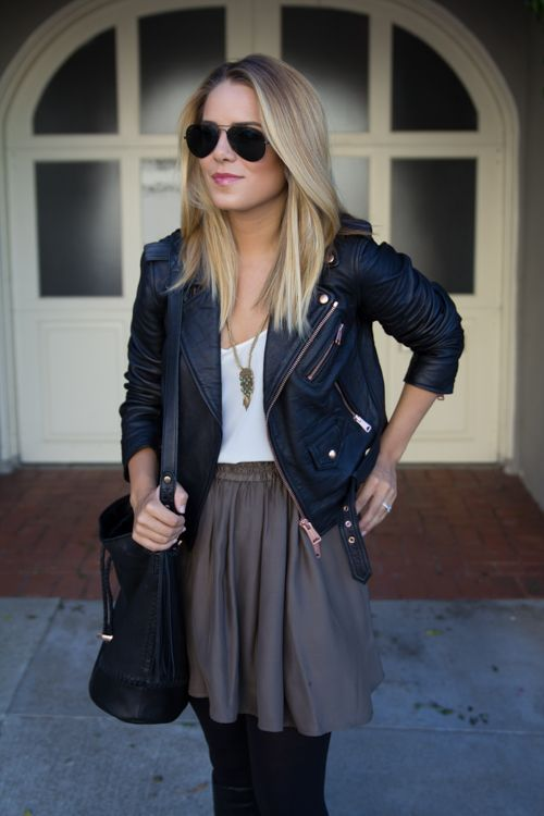 you can make a go-summer outfit of a skirt and tank top work for fall by adding tights and a leather jacket: