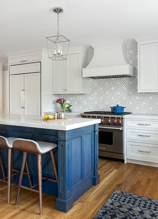 Low Back Wooden Counter Stools Sit At A Blue Washed Wood Island