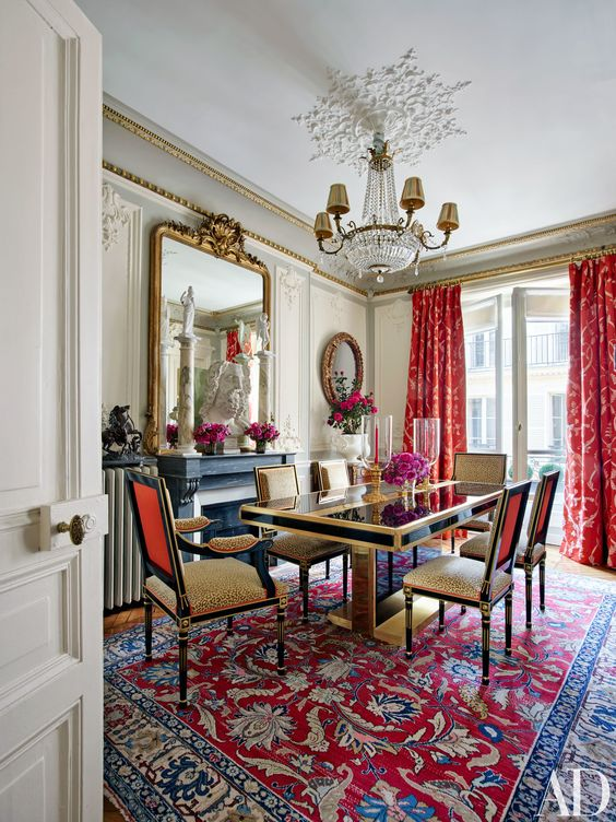 Curtains of a Timothy Corrigan Collection fabric for Schumacher make a brilliant splash in the dining room | archdigest.com