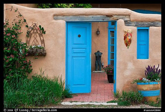Adobe style walls blue doors and windows and courtyard for Adobe house plans with courtyard