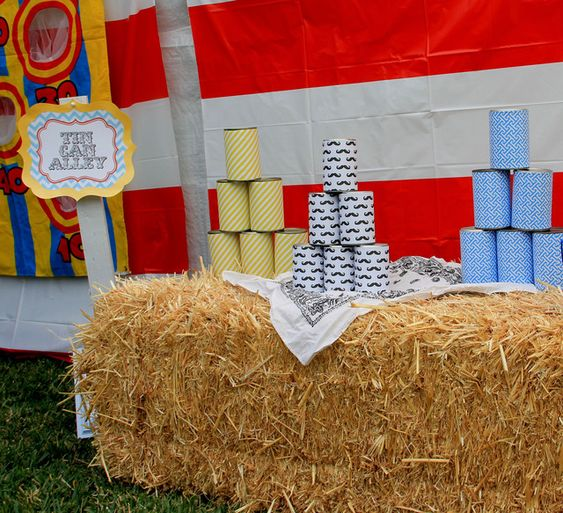 Tin Can Alley game at a Curious George party.  See more party ideas at CatchMyParty.com.  #monkey #partyideas