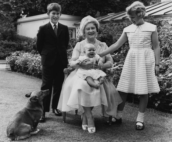 4 August 1960: Queen Elizabeth the Queen Mother poses in the garden of Clarence House on the occasion of her 60th birthday, with her grandchildren Prince Charles, Princess Anne and a six-month-old Prince Andrew