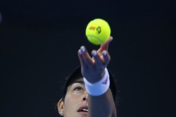 Ana Ivanovic of Serbia serves to Maria Sharapova of Russia during their women's singles semi-final match at the China Open tennis tournament in Beijing October 4, 2014. REUTERS-Petar Kujundzic