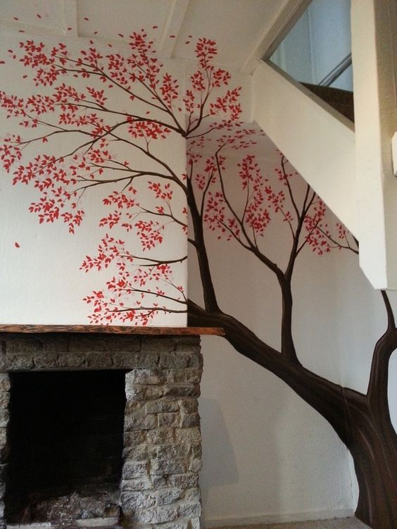 This pretty blossom tree mural was painted under the ...