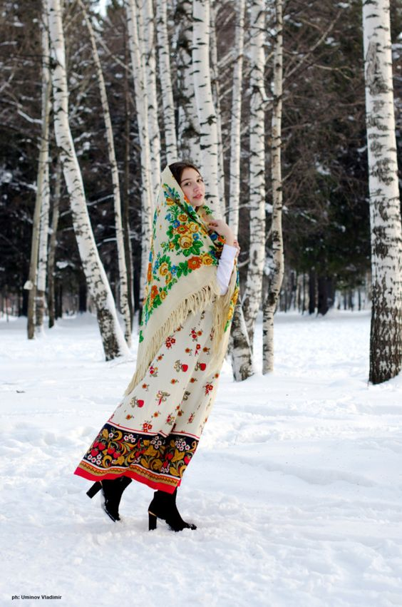 A Russian girl in the winter landscape with birch trees. #Russia