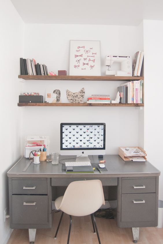 Modern home office. Love the industrial gray metal desk with the wood shelves. Great contrast.